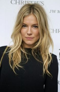 Sienna Miller--my hair idol.  Her middle part, long bangs, and gorgeous ash-natural blonde shade are always perfection.  I love how she looks as if she did nothing at all  to get her gorgeous waves!