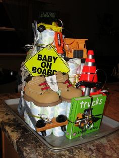 "Baby shower that was a construction theme. Construction Trucks, work boots, tools, mini traffic cone, baby book about trucks and a blinking ""caution ahead"" sign. Baby Boy Gift Baskets, Baby Shower Baskets, Baby Shower Gifts For Boys, Baby Shower Signs, Boy Baby Shower Themes, Baby Boy Gifts, Baby Shower Parties, Baby Boy Shower, Diaper Cake Boy"