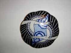 Gustav Gaudernack. Silver and enamel brooch with another variant of the swan motif on guilloche silver ground. Own Workshop. 1901-1914