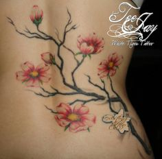 cherry blossom tattoo with 7 blossoms, (2 for parents and 5 for grandparents) with frog on limb/trunk