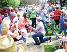 Dallas Hutchison proposes to Lizzie Christy Saturday at the Mule Day Parade. The Chantilly, Va., residents are friends of Columbia native Jim Poling. Staff photo by Kelly Quimby