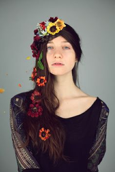 I mean... this photo is gorgeously ridiculous. Loving the flowers in her hair.