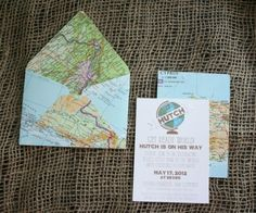 She used pages from an atlas for the envelopes and other decor for the party.  Genius!