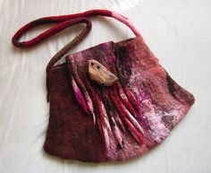 http://www.coastcollective.ca/images/DanaSitar_FeltedBag_LG.jpg (I like the feral feeling of the colour change, very organic , ELM)