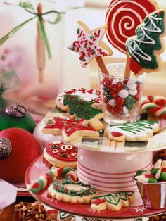 Holiday party treats... this three-tier display shows off treats for a cookie swap or any holiday gathering. Tri-color Candy Cane Cookies, frosted Sugar Cookies Like You Remember and fudgy Nutcracker Brownies surround small cups of bright-red, green and white candies.