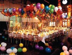 (large size) balloon centerpieces of picnic tables fill up ceiling of shelter
