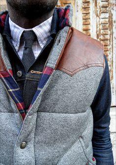 Grey jacket & plaid shirt.