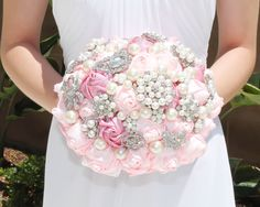 This brooch bouquet is handcrafted with beautiful brooches, colorful satin ribbon flowers in perfect combination of dark and light pink, and lustrous pearls. Diameter : 8.5 inches. This product is mad