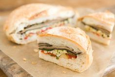 This pressed sandwich is a vegan version of the New Orleans classic that uses mushrooms and pine nuts rather than meat and cheese. The size and hearty texture of portobello mushrooms make them perfect for this sandwich.