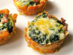 Grab and go sweet potato muffins filled with egg, spinach and sausage -- use yam slices in place of tots & veggie sausage in place of ham. lg. yam sliced, 9 oz. frozen spinach, 5 eggs beaten, 1/2C cooked sausage bits, salt/pepper, grated cheese for topping. 400. Grease 12-cup muffin pan. line w/ yam slices, cook 10 min, remove. 350. mix remaining well, spoon into cups, top w/ cheese. Bake 20 min.