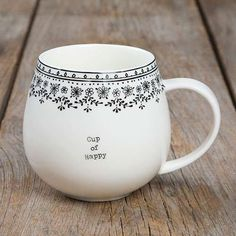 "This ""Cup of Happy"" Mug is so cute! It features a large handle, simple font and a fun and original border at the rim!"