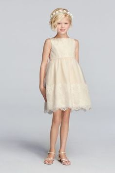 Perfect for a romantic wedding, this flower girl dress will add a soft, vintage feel to the bride's special day.  Features delicate tulle with lace appliques on bodice and skirt.  Skirt hem falls right above the knee.  Attached ribbon on waist.  Fully lined. Back zipper. Dry clean only.