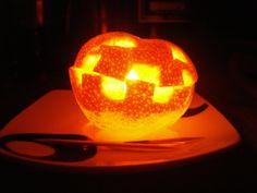 How to make a Halloween Tangerine Candle.  It's a mini jack-o-lantern!! :D