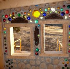 cordwood homes – add bottles for color and light. cordwood homes – add bottles for color and light. Wine Bottle Garden, Bottle House, Bottle Wall, Cob Building, Green Building, Building A House, Casas Cordwood, Cordwood Homes, Earthship Home