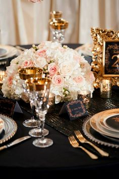 Blush ivory black and gold wedding centerpieces