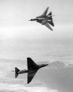 F-14 Tomcat and A-4 Skyhawk commencing a dogfight.