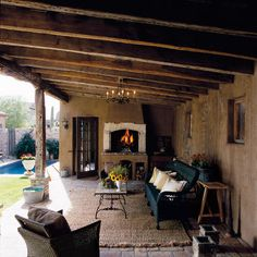 Covered porch area: floor, rug, wall, old world feel