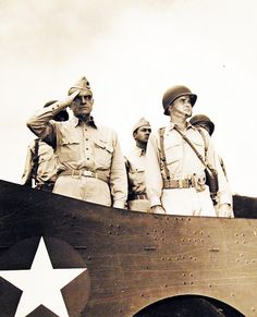 80-G-40707: Admiral William F. Halsey, Jr., USN, Commander South Pacific area and South Pacific Force, reviews American troops from a U.S. Army truck at a South-western Pacific base. To the right of Admiral Halsey is Colonel Glen Cunningham, USA. Photograph released February 1943. U.S. Navy Photograph, now in the collections of the National Archives.
