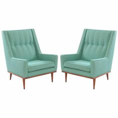 Vintage pair of late 1950's Milo Baughman lounge chairs with subtly tapered backs, aqua tweed upholstery, & solid walnut legs