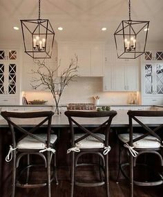 """White cabinets with """"X"""" mullions and oversized pendant lighting #mykitchenvision"""
