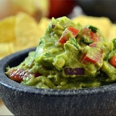 This tasty guacamole uses the traditional ingredients of avocados, onion, tomatoes, and lemon juice.