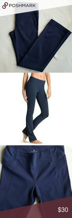 Athleta Straight Up Pant Slim straight fit athletic pant in Athleta's performance fabric. Sweat wicking, odor resistant. Straight up pant is mid-rise with a slim straight leg. Very flattering seams with hidden waistband pocket. Gorgeous navy color. Some light pilling on the inner thighs. Athleta Pants Leggings