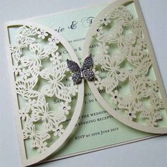 This butterfly laser cut wedding invitation is finished with a crystal butterfly and a mint green insert.
