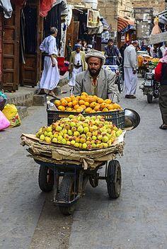 Man selling fruit in the Old Town, UNESCO World Heritage Site, Sanaa, Yemen…