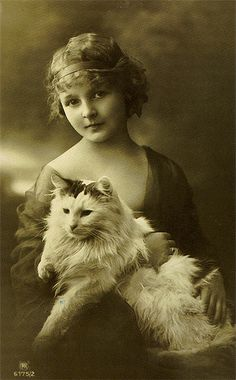 Vintage portrait of a young woman and her beautiful cat