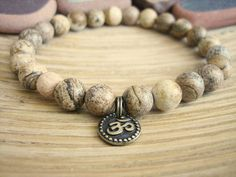 Pandora Jewelry OFF!> Mens Om Bracelet - Picture Jasper Bracelet with Tulsi Wood Mala Bead Mens Bracelet with Brass Charm Pandora Bracelets, Pandora Jewelry, Men's Jewelry, Fashion Jewelry, Bracelets For Men, Beaded Bracelets, Leather Bracelets, Schmuck Design, Bracelet Designs