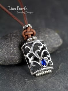 Here is a bit of open work I did with combining sterling silver and fine silver metal clay.  I bezel set a small blue sapphire. -Lisa Barth