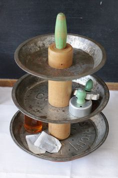 Awesome tiered display from old pie tins and vintage rolling pin