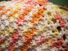 Sarah from Blooming Patterns shares the free crochet dishcloth pattern called Little Starbursts.