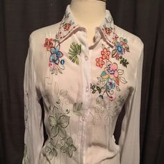 """Embroidered Sheer """"Western"""" Blouse by DB Sport This 100% rayon sheer white """"Western"""" inspired blouse is perfect paired with a colorful cami, jeans, and of course, your favorite pair of boots. Yee haw! Stitched floral design is ALL over this top (even on the sleeves). Missing two buttons on the front (an easy fix). DB Sport Tops Button Down Shirts"""