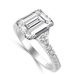 Emerald cut with Trilliants A beautiful, high-quality emerald cut is set with shoulder trilliants, in 18 carat white gold. This design is also available in platinum