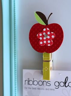 Apple Pin - thinking instead of apple, a big polka dot or other shape with student pic. in center.  Add a magnet and it becomes a hanger for child's work.