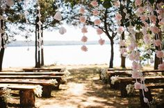 Find a wy to make guests walk through garlands of flowers and clocks to their seats.... Down the rabbit hole!