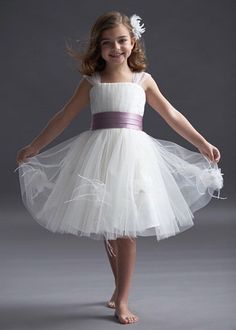 Tulle with square neckline and full knee-length skirt.