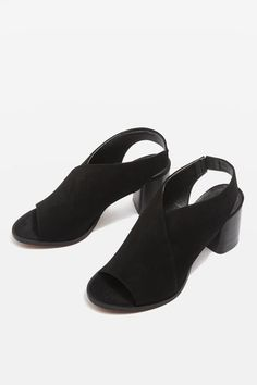 Let these sleek shoes flawlessly transition you from day-to-night. In a chic black leather suede, they come with a wooden-style mid heel – ideal for everyday wear.