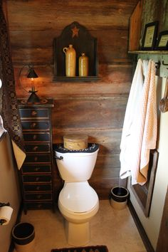 Primitive bathroom..Barn wood wall. Funny to say but this is my favorite area.