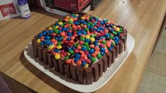 Simple and fun my niece's and nephews loved it. Made a vanilla cake cut in half and put chocolate pudding frosted with vanilla cream cheese frosting and decorated with kit kats and m&m's. So many more ideas.