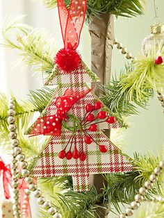 Cute tree ornament. Easy to make I cut out of foam sheets then glued Christmas scrapbook paper and edged with glitter.