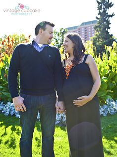 Couple looking at each other for maternity pegnancy session in park Denver, Colorado Maternity Photographer The Vintage Cupcake Photography