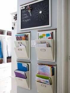 Avoid a jumbled mess of mail and school papers by setting up a message center and inbox for each family member. Use the area to corral artwork, homework assignments, forms, and magazines as soon as they enter the house. At each week's end, go through the contents of each box; discard old material and file away things you want to keep. Via itswrittenonthewalls.blogspot.com