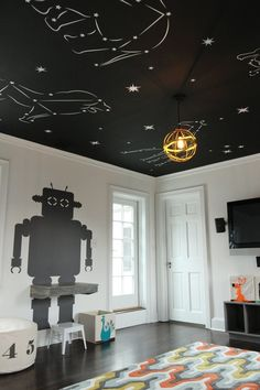 """Project by: Barette Widell of Widell Designs  Location: Flourtown, Pennsylvania   Designed by interior decorators Widell Designs, the kid's playroom for a 5-year-old features a constellation of animals on the ceiling, built in shelves and desks, a pint-sized tepee and interactive chalkboard. The designers Barette and Christina explain, """"the client really had no vision in mind, so we were able to run wild with ours… starting with the ceiling."""""""