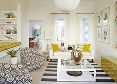 A modern black and white living room with yellow accents
