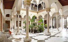 Palacio de Villapanés  This grand, former 18th-century palacio in Seville feels every inch the five-star, Andalusian palace it is. There are Moorish arches and ornate, jewel-coloured tilework, mottled marble pillars and parquet floors, but also highly contemporary, minimalist, monochrome styling throughout. The hotel is a peaceful sanctuary from the heat and bustle of central Seville, although you're still not too far from main sights like the cathedral.