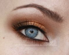 Make blue eyes pop! White corner to dark gold subtly smokey eyes.