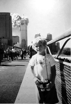 9/11  (What the heck was going on with this photo? Did another person not want him to see the towers burning & so distracted him?)