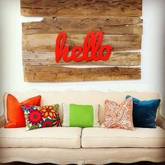 """hello"" #orange #pallet #art #sofa #couch #living #room #diy"